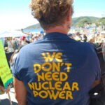 "Photo of a women's t-shirt reading ""We don't need nuclear power""."